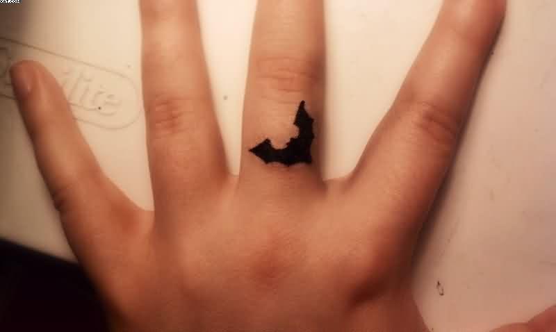 Little Black Bat Tattoo On Finger