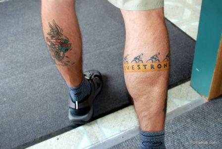 Live Strong Bike Tattoo On Leg