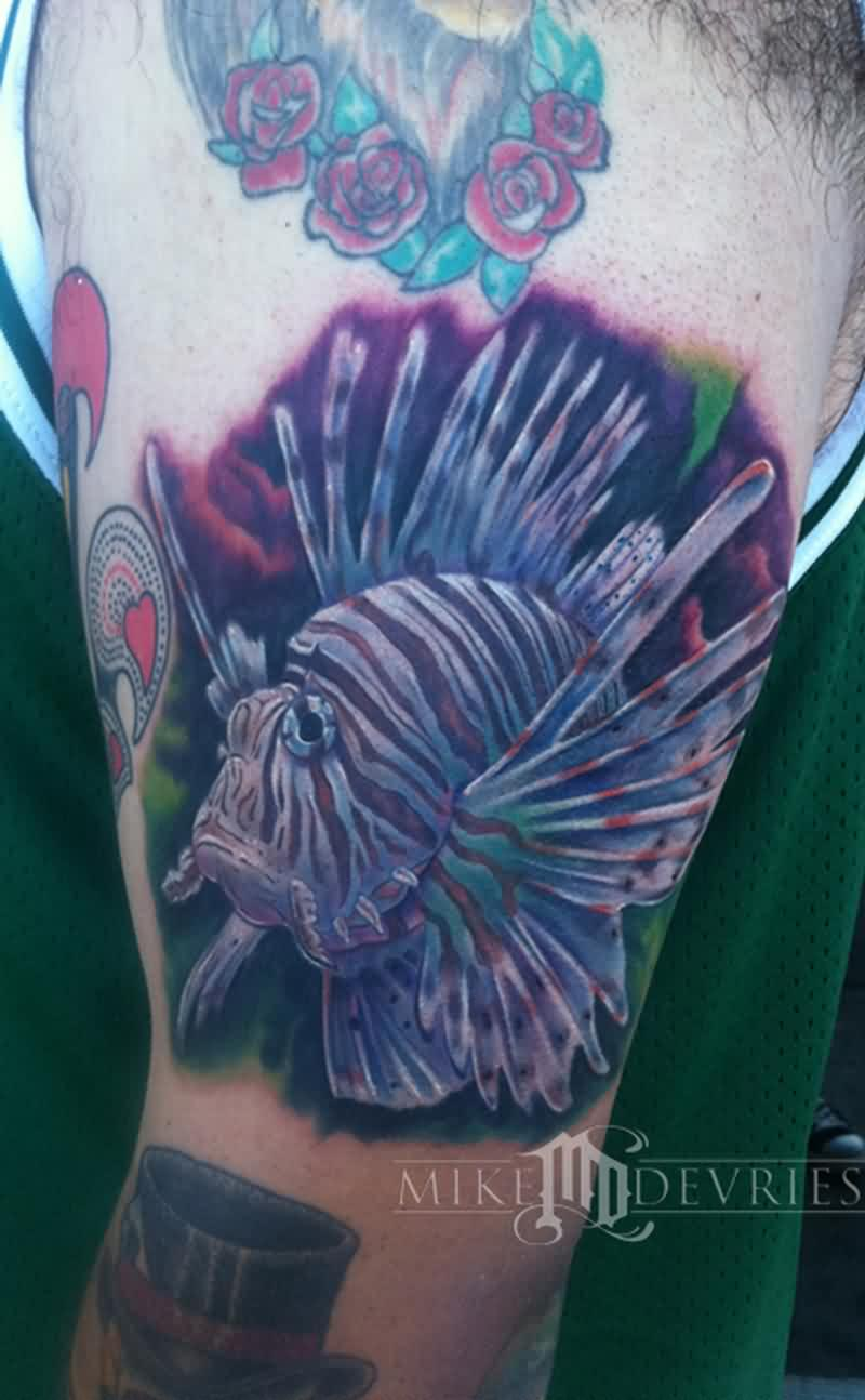 Lovely Lion Fish Tattoo On Biceps
