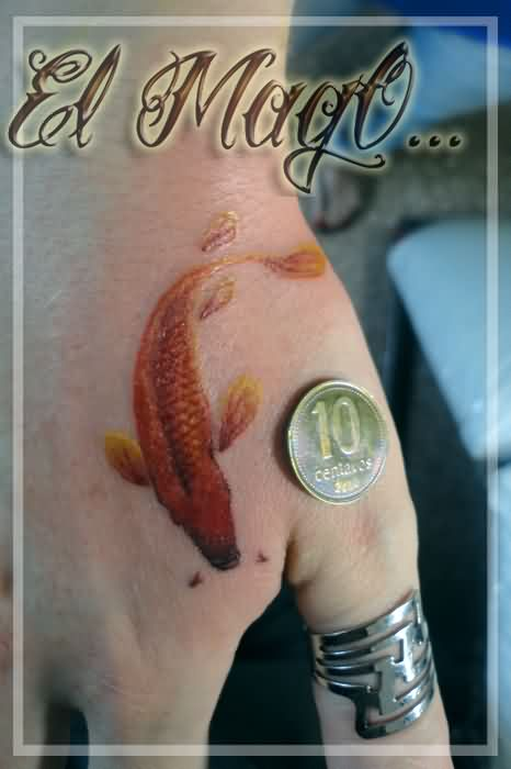 Mini Koi Fish Tattoo On Hand And A Coin