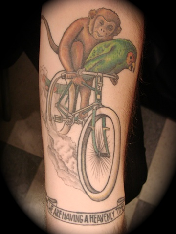 Monkey And Parrot Ride Bike Tattoo Design