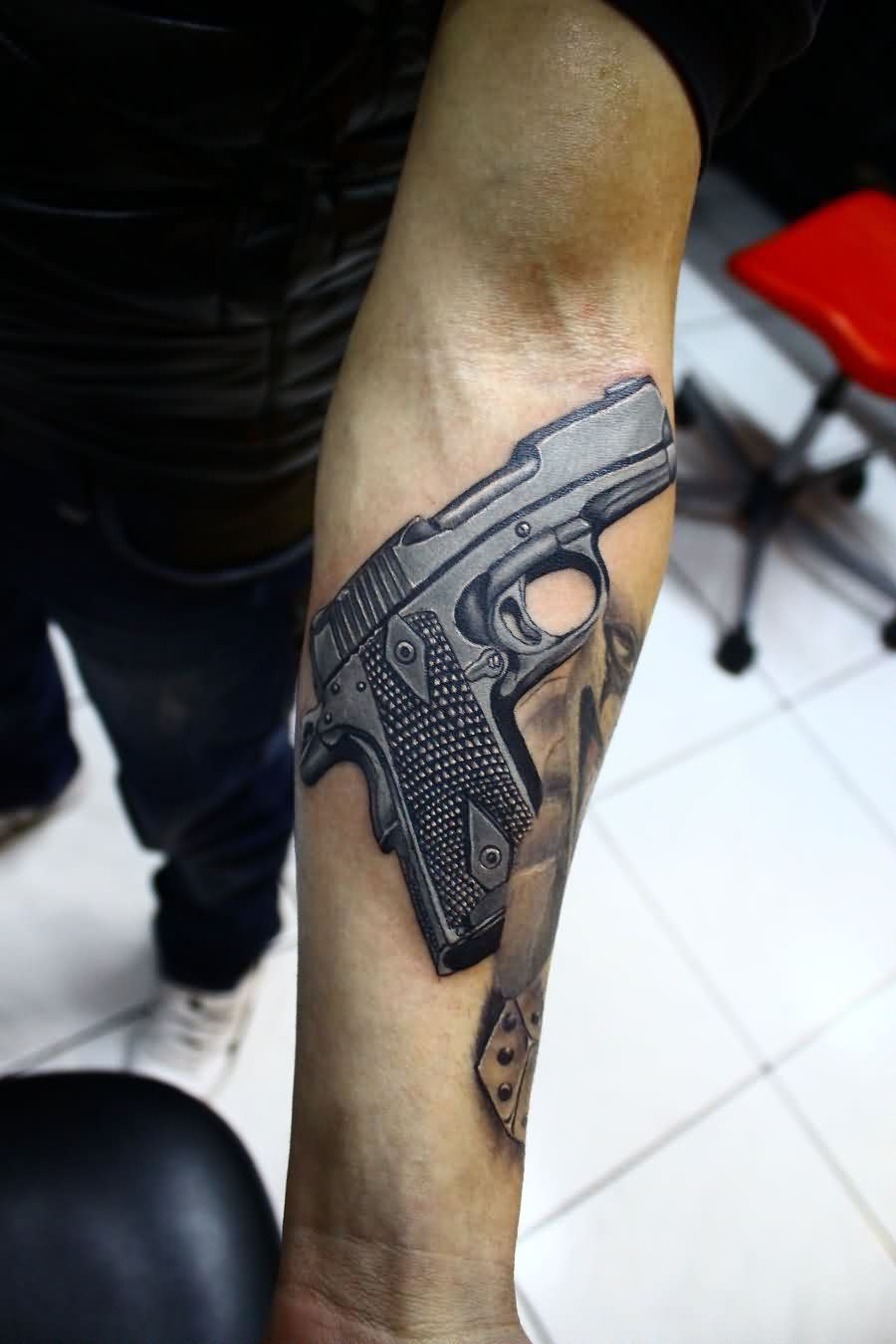 Realistic Gun Tattoo On Arm