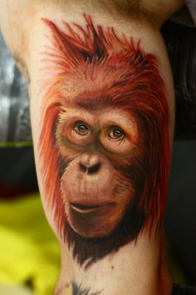 Realistic Monkey Face Tattoo On Muscles