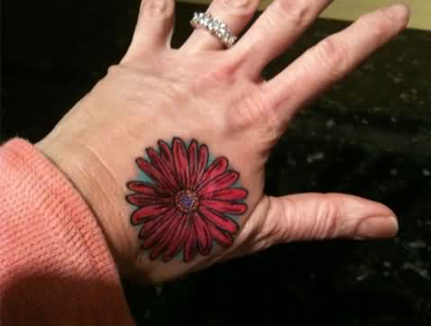 Red Ink Daisy Tattoo On Hand