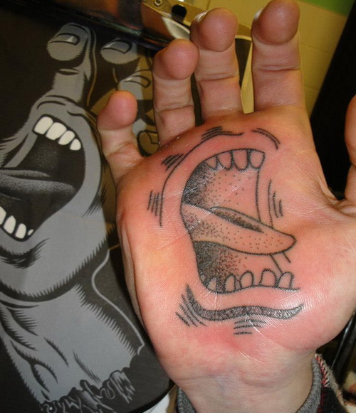 Screaming Face Tattoo On Palm Of Hand