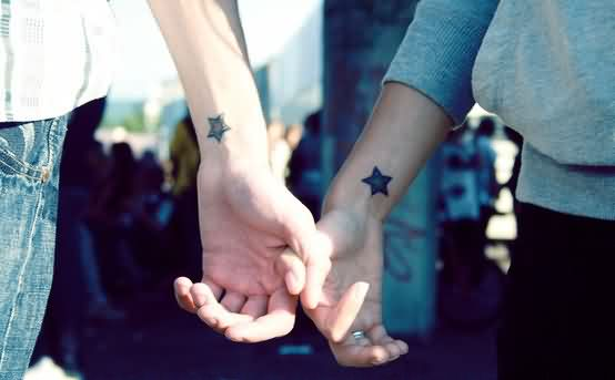 Stars Tattoos On Couple Wrists