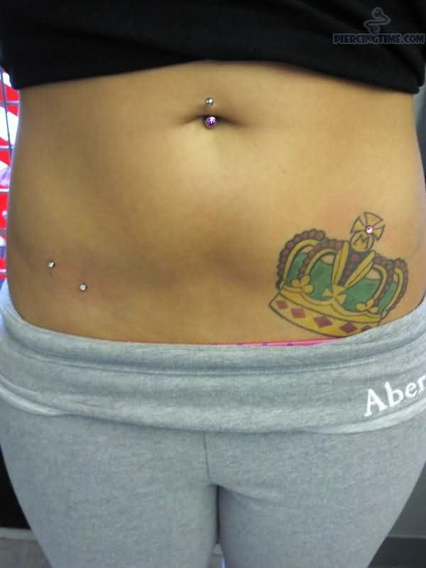 Surface Piercing For Hip And Crown Tattoo