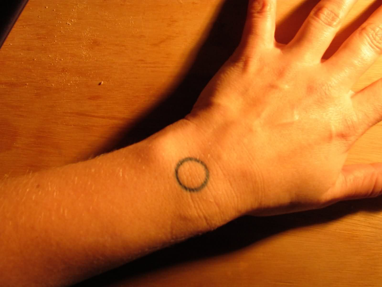 Tiny Circle Tattoo For Wrist