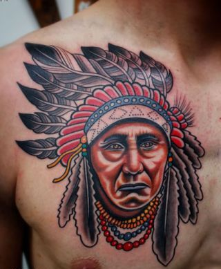 Traditional Indian Face Tattoo On Chest