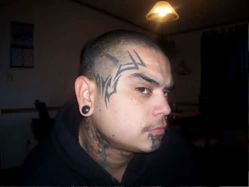 Tribal Face Tattoo For Guys
