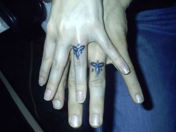 Trinity Ring Couple Tattoos On Fingers