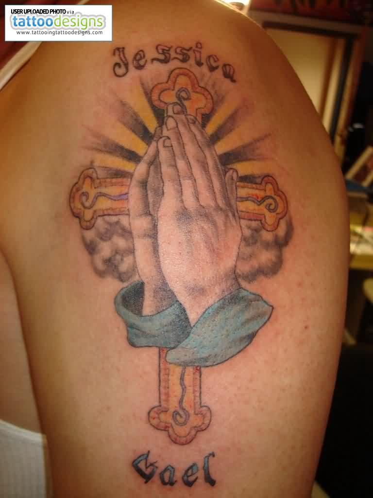 Upper Arm Cross And Praying Hands Tattoo