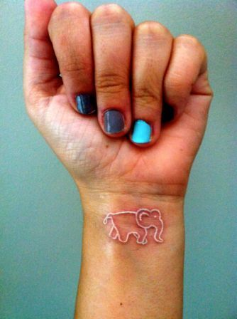 White Ink Elephant Tattoo On Wrist