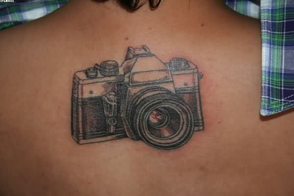 Wonderful Camera Tattoo On Upper Back
