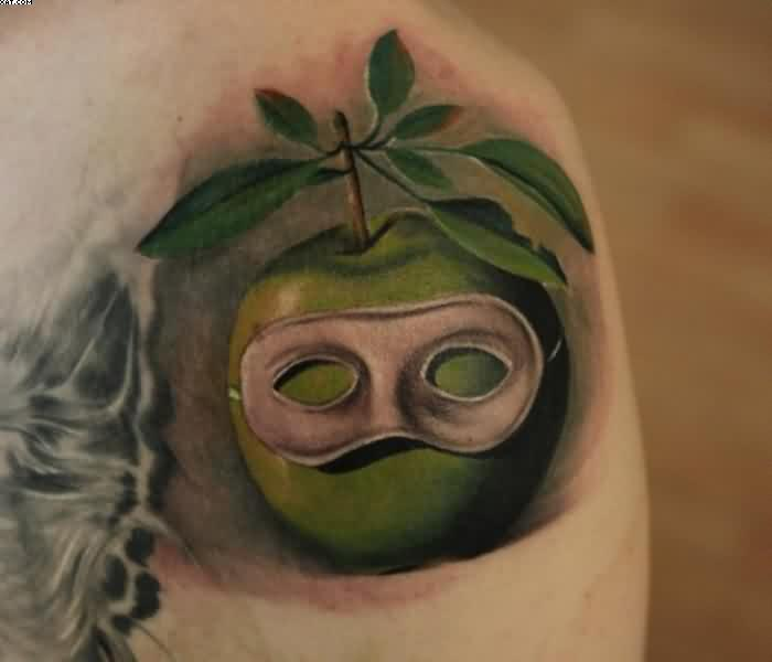 3D Apple Mask Tattoo On Shoulder