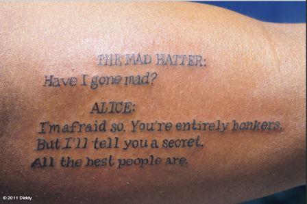 Alice In Wonderland Literary Tattoo On Arm
