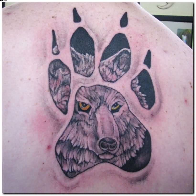 Amazing Wolf Paw Tattoo On The Back