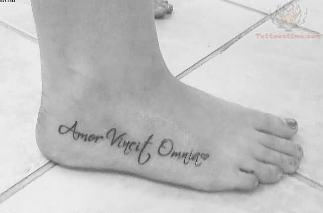 Amor Vincit Omnia Words Tattoo On Right Foot