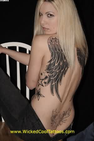 Angel Wings And Star Tattoos On Sexy Back