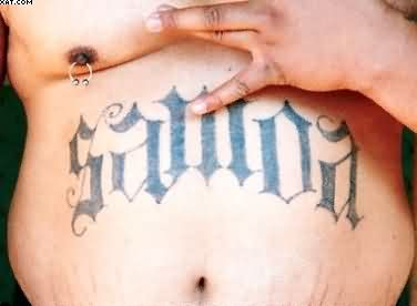 Big Word Tattoo On Stomach