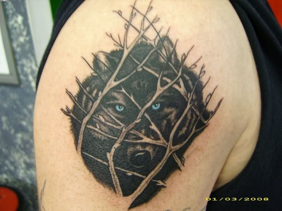 Black Wolf With Blue Eyes Tattoo On Shoulder