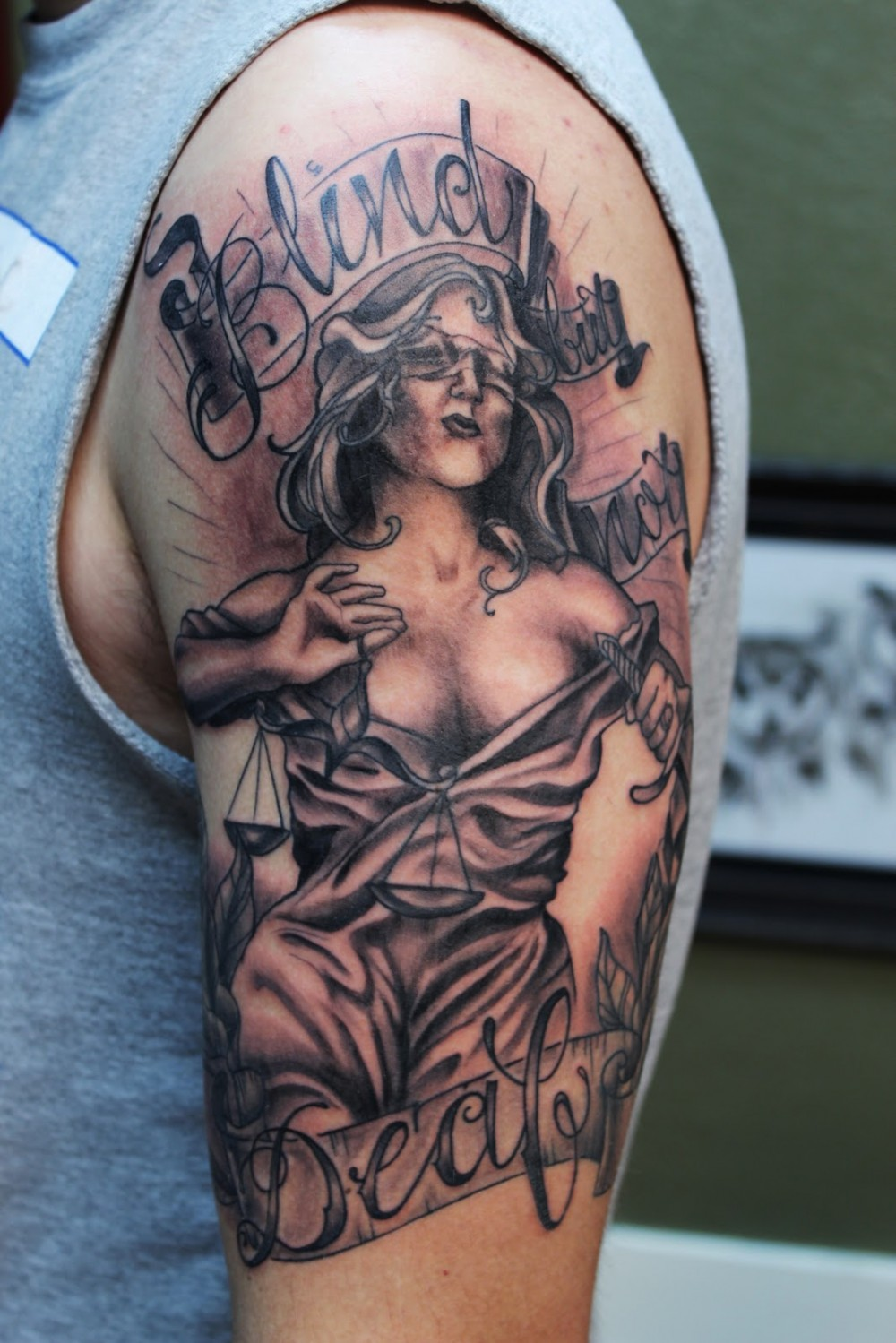 Blind Deaf Lady Justice Tattoo On Biceps
