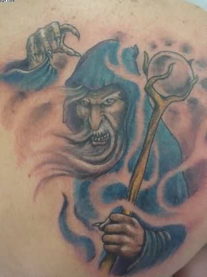Blue Ink Wizard Tattoo On Chest For Men