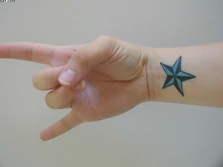 Blue Nautical Star Tattoo On Wrist