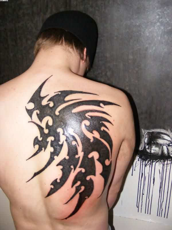 Bold Black Tribal Wing Tattoo On Back For Guys