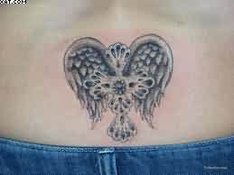 Celtic Cross With Wings Tattoo On Lower Back