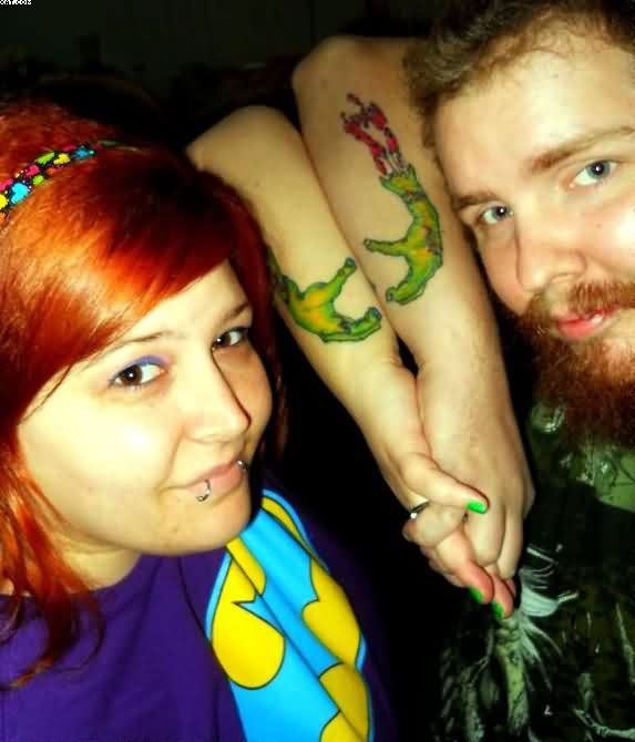 Couple Having Zombie Hands Tattoos
