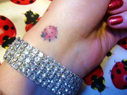 Cute Ladybug Tattoo On Wrist