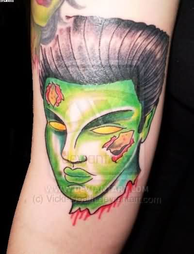 Green Ink Zombie Face Tattoo