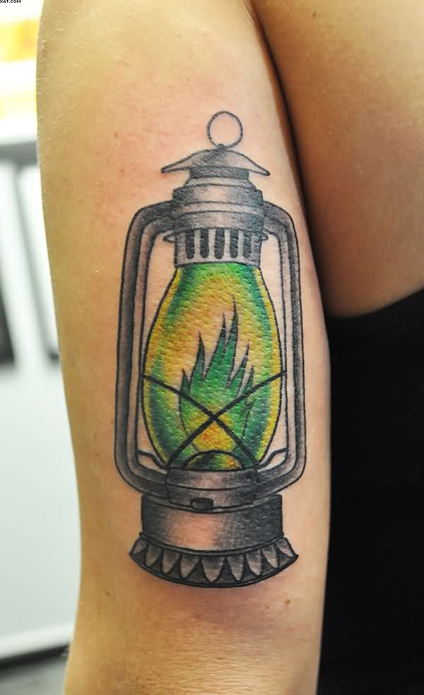 Green Lamp Tattoo On Back Of Arm