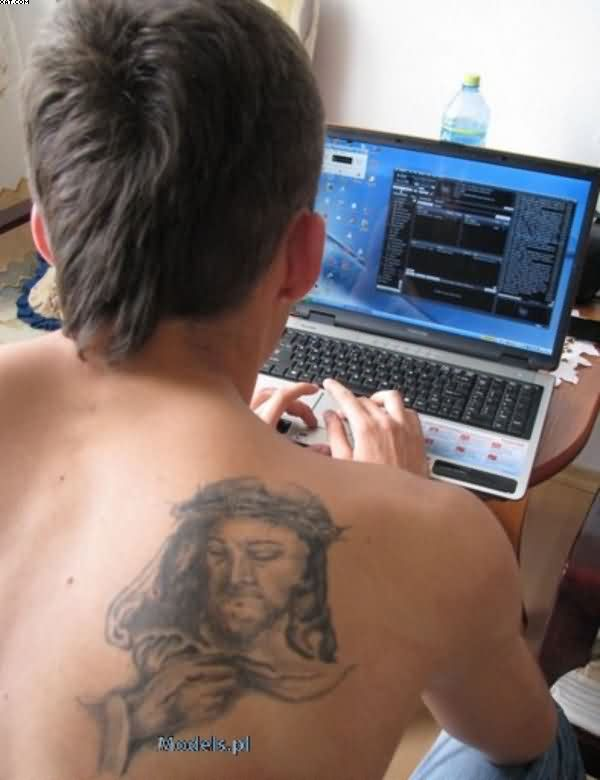 Grey Ink Jesus Tattoo On Right Back Shoulder