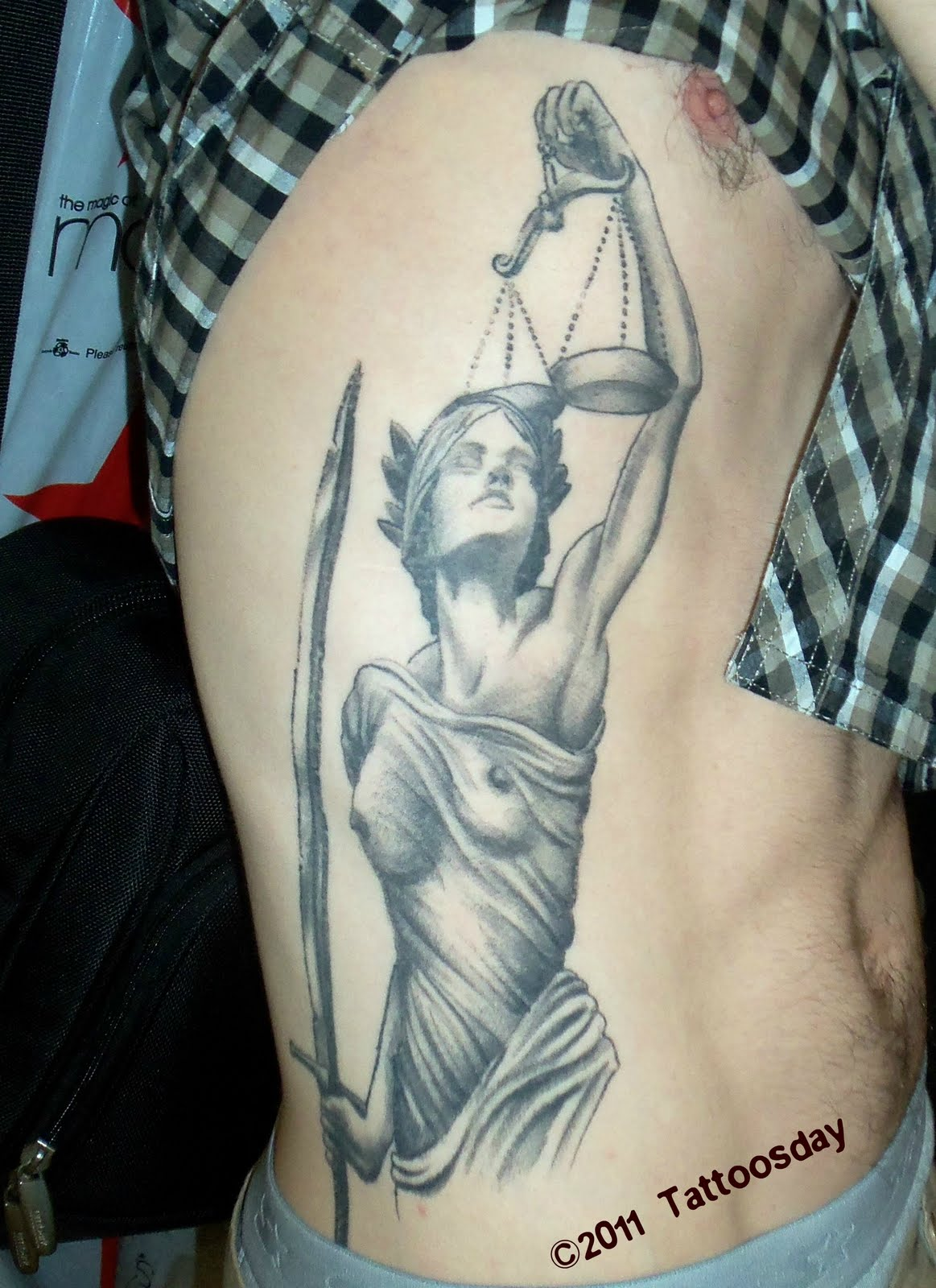 Grey Ink Lady Justice Tattoo On Ribs
