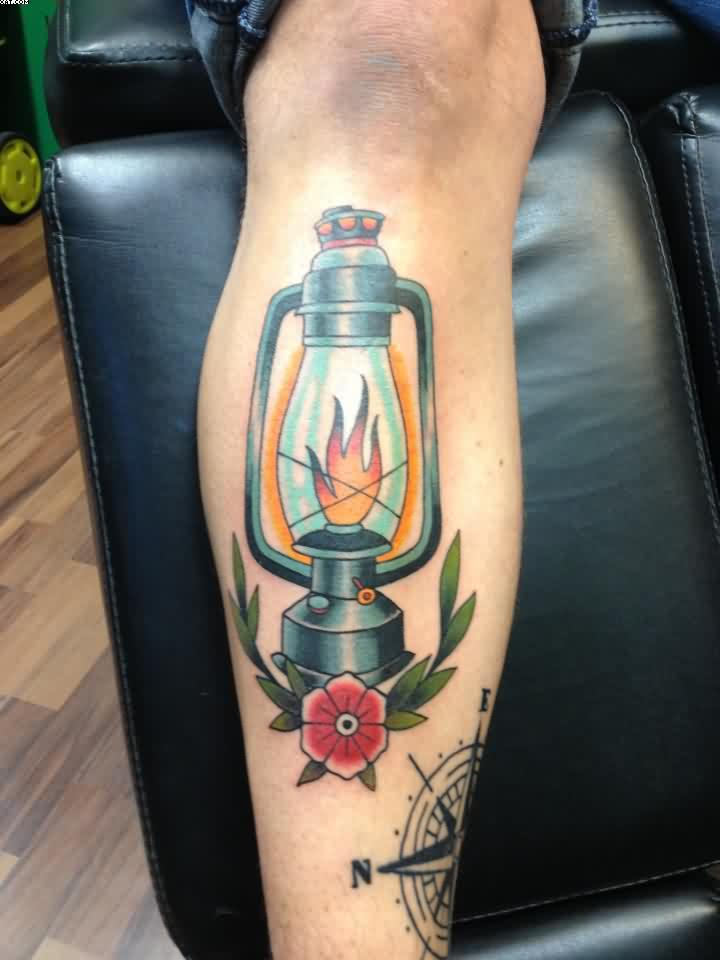 Lamp And Red Flower Tattoo On Leg
