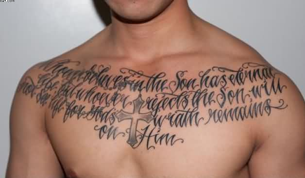 Lettering And Cross Tattoos On Chest