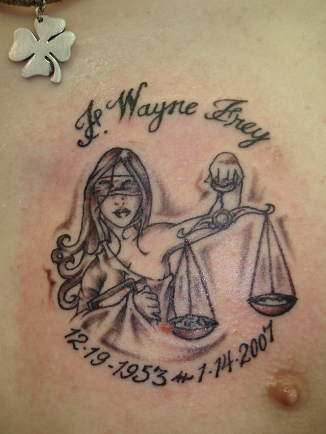 Memorable Lady Justice Tattoo On Chest
