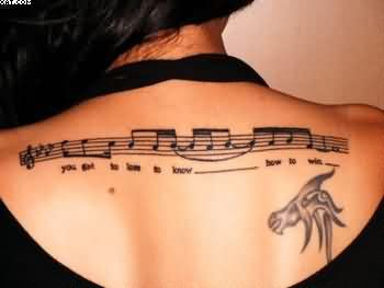 Nice Music Notes Words Tattoos On Upper Back