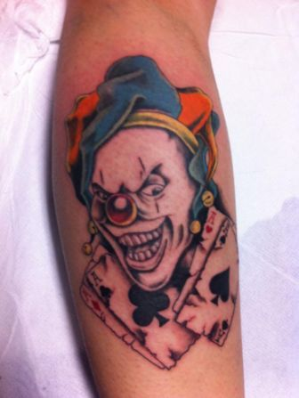 Red Nose Joker With Cards Tattoo On Leg