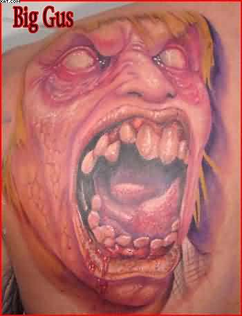 Screaming Zombie Face Tattoo On Back Shoulder