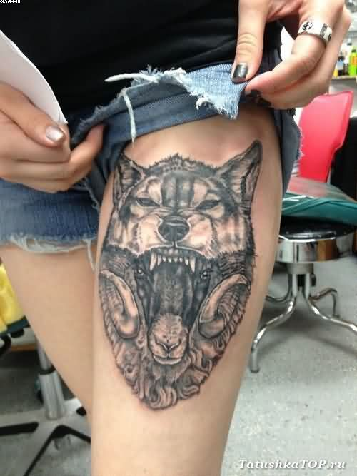 Sheep In The Jaws Of The Wolf Tattoo On Thigh