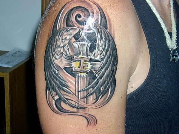 Shining Angel Wings With Cross Tattoo On Biceps