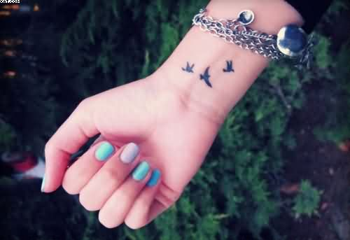 Three Flying Birds Tattoos On Wrist