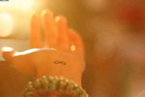 Tiny Infinity Symbol Tattoo On Wrist