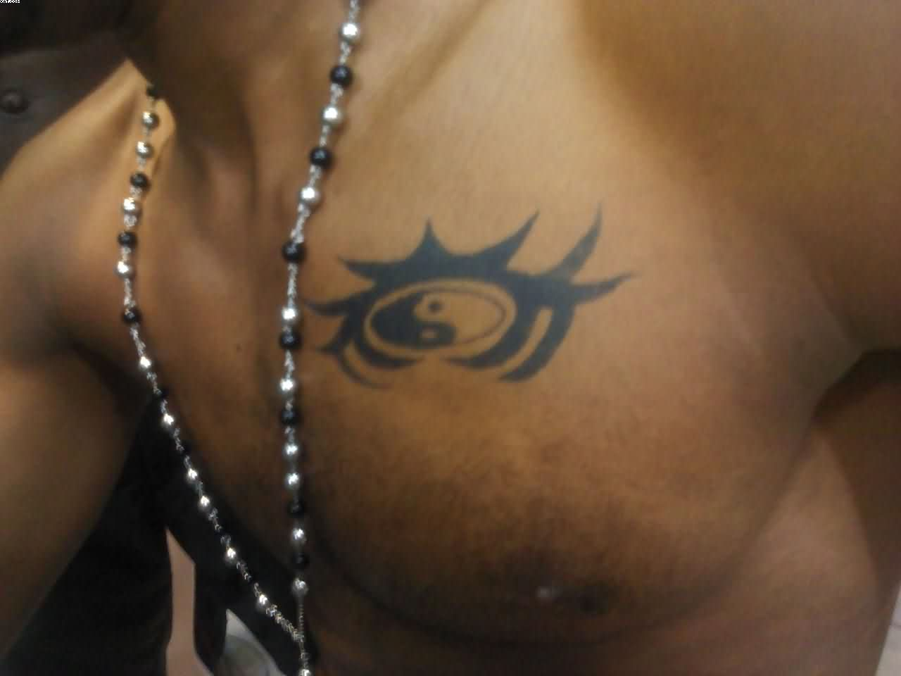 Tribal Ying Yang Tattoo On Chest