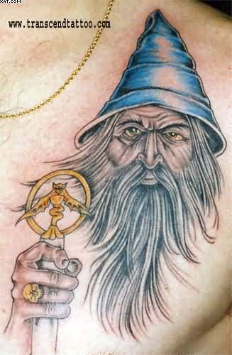 Wizard With Blue Hat Tattoo On Chest