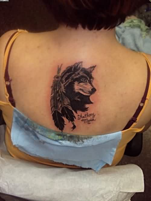 Wolf And Feathers Tattoos On Back Of Female