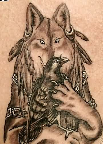Wolf Holding Crow In Paws Tattoo